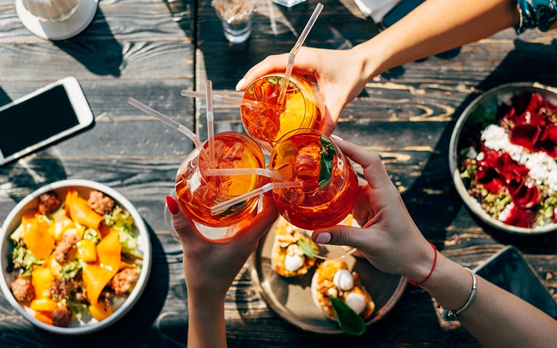 Three friends toasting with Spritz
