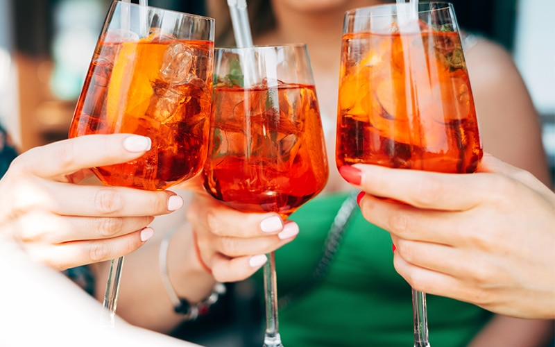 Three friends drinking spritz