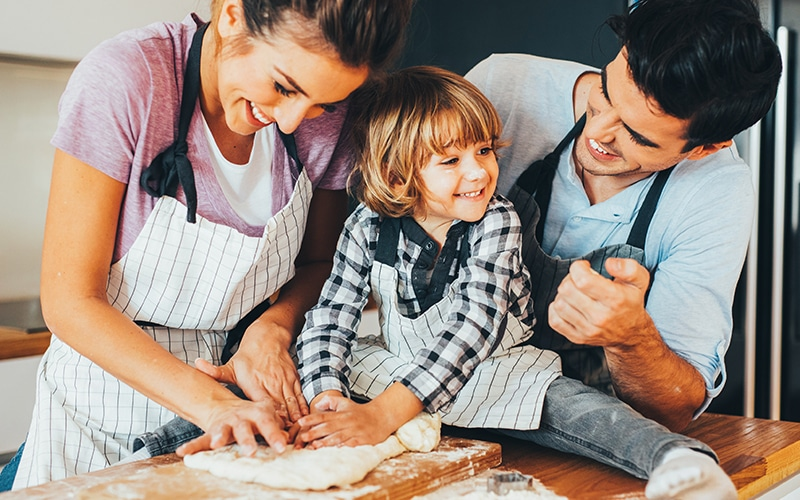 Mom, Dad and son kneading together