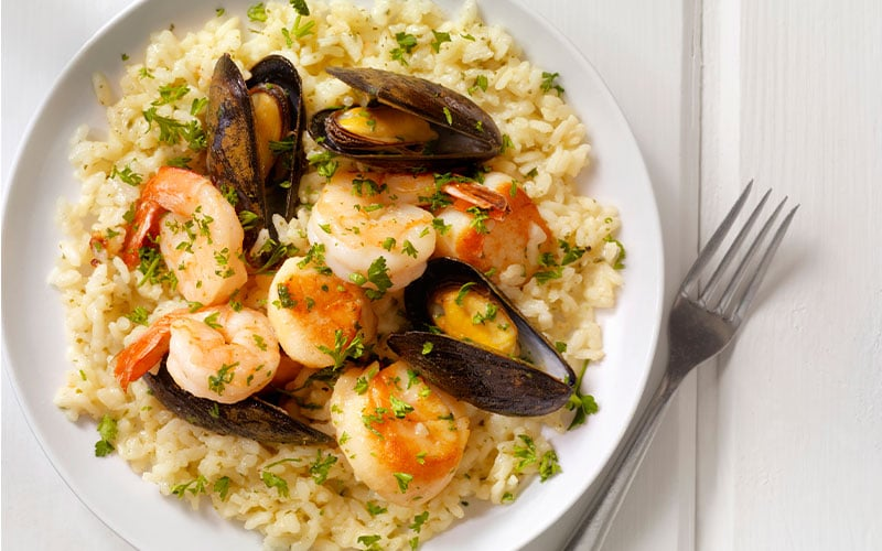 a plate of seafood risotto